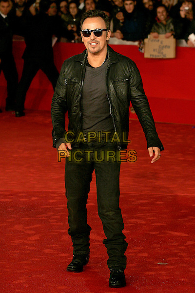 "BRUCE SPRINGSTEEN.premiere of ""The Promise: The Making Of Darkness On The Edge Of Town"" during the Rome International Film Festival, Rome, Italy, .November 1st, 2010..full length jeans sunglasses black leather jacket grey gray .CAP/PE.©Peter Eden/Capital Pictures."
