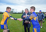 Newmarket  captain Colin Ryan is congratulated by opposition player Niall Gilligan as he accepts the cup from Clare GAA chairman Joe Cooney following their win over Sixmilebridge in the Clare Champion Cup final at Clonlara. Photograph by John Kelly.