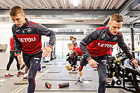 (L-R) Tom Carroll and Andy King exercise in the gym during the Swansea City Training and Press Conference at The Fairwood Training Ground, Swansea, Wales, UK. Thursday 01 February 2018