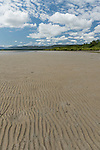 Cooya Beach, Port Douglas, Australia; wavy patterns in the sand along the shoreline at low tide