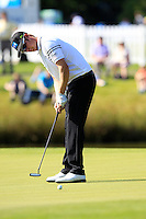 Mikko Ilonen (FIN) sinks his putt on the 18th green to takes the lead on -10 after finishing his match during Friday's Round 2 of the 2014 Irish Open held at Fota Island Resort, Cork, Ireland. 20th June 2014.<br /> Picture: Eoin Clarke www.golffile.ie