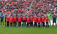 21 April 2012: The Chicago Fire players stand at attention during the opening ceremonies and national anthems in a game between the Chicago Fire and Toronto FC at BMO Field in Toronto..The Chicago Fire won 3-2....