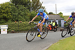 Dan Martin (Garmin-Sharp) leads Damien Shaw through Crookedwood during the Irish National Men's Elite Road Race Championships held over an undulating course featuring 9 laps centered in the village of Multyfarnham, Co.Westmeath, Ireland. 29th June 2014.<br /> Picture: Eoin Clarke www.newsfile.ie