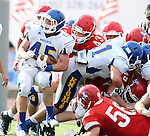 SIOUX FALLS, SD - SEPTEMBER 7: Matt White #45 from O'Gorman tries to back in to the end zone past  Dalton Jones #43 from Lincoln in the second quarter of their game at the 2013 Presidents Bowl at Howard Wood Field. (Photo by Dave Eggen/Inertia)
