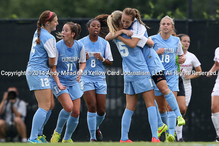 07 September 2014: North Carolina's Summer Green is lifted off the ground by North Carolina's Katie Bowen (NZL) (15) while celebrating her goal with teammates Jessie Scarpa (12), Darcy McFarlane (11), Amber Munerlyn (8), and Megan Buckingham (18). The University of North Carolina Tar Heels played the University of Arkansas Razorbacks at Koskinen Stadium in Durham, North Carolina in a 2014 NCAA Division I Women's Soccer match. UNC won the game 2-1.