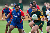 Graham Dewes gets the pass away before being tackled . Counties Manukau Premier Club Rugby game between Ardmore Marist and Pukekohe played at Bruce Pulman Park on Saturday April 17th..Pukekohe won the game 25 - 0 after leading 15 - 0 at halftime.