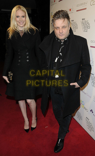 guest & Rankin (John Rankin Waddell).The WGSN Global Fashion Awards, Savoy Hotel, The Strand, London, England..November 5th, 2012.full length black jacket coat stubble facial hair scarf .CAP/CAN.©Can Nguyen/Capital Pictures.