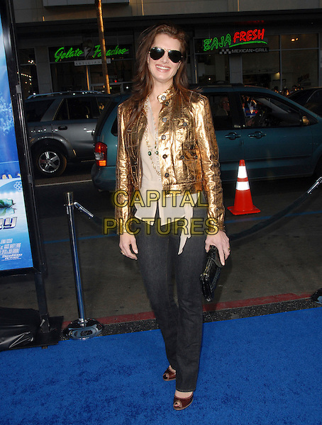 "BROOKE SHIELDS.Attends The Paramount Pictures L.A. Premiere of ""Blades of Glory"" held at The Graumann's Chinese Theatre in Hollywood, California, USA. .March 28th, 2007.full length jeans denim gold jacket beige sheer top black clutch purse sunglasses shades .CAP/DVS.©Debbie VanStory/Capital Pictures"