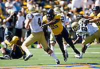 September 4, 2010:  Ernest Owusu of California tries to bring down Kevin Prince of UCLA during a game at Memorial Stadium in Berkeley, California.    California defeated UCLA 35-7