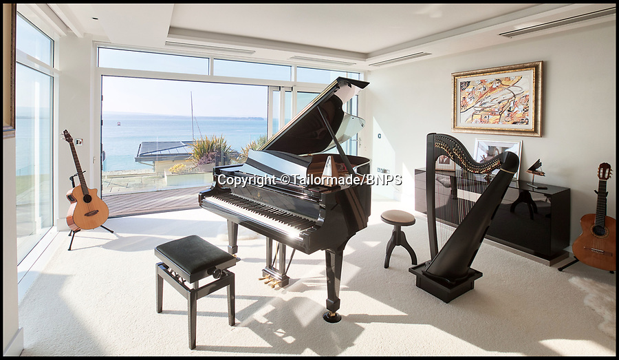 BNPS.co.uk (01202) 558833<br /> Pic: Tailormade/BNPS<br /> <br /> You can play your Grand piano until the sun goes down...<br /> <br /> tunning super home for sale - If you've got £9 million to spare...<br /> <br /> This state of the art mega-home is for sale on the exclusive millionaires playground of Sandbanks in Poole, Dorset.<br /> <br /> The biggest, most expensive, and luxurious home ever to come on the market on the tiny peninsula, it is now selling for a cool £8.75m.<br /> <br /> Called The Moorings, the harbour front mansion has stunning sea views, and is on one of the most enviable plots on Millionaire's Row.<br /> <br /> Its owners, entrepreneur Chris Thomas and wife Sue, spent a staggering £5.5m building the palatial home that has been compared to a five star hotel.<br /> <br /> Spread over 13,000 sq ft - the equivalent size of seven detached houses - the state-of-the art property comes with five en suite bedrooms, three reception rooms, an office, cinema room, indoor swimming pool, sauna, gym, gate house and boat house.