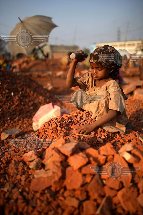 A young girl working in a brick crushing factory in Dhaka. It is common in Bangladesh for children of poor parents to work in various hazardous and labour-intensive workplaces to support their families. 17.5 percent of all children aged between 5-15 are engaged in economic activities. The average child labourer earns between 400 to 700 taka (1 USD = 70 taka) per month, while an adult worker earns up to 5,000 taka per month.