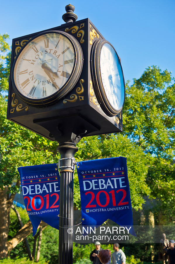 """Oct. 11, 2012 - Hempstead, New York, U.S. - Debate 2012 banners, here under clocks on post, are throughout Hofstra University campus. """"Debate 2012 Pride Politics and Policy"""" is a series of events leading up to when Hofstra hosts the 2nd Presidential Debate between Obama and M. Romney, on October 16, 2012, in a Town Meeting format."""