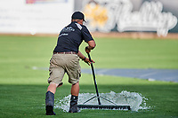 The grounds crew readies the field after a rain delay as the Omaha Storm Chasers faced the Salt Lake Bees in Pacific Coast League action at Smith's Ballpark on May 8, 2017 in Salt Lake City, Utah. Salt Lake defeated Omaha 5-3. (Stephen Smith/Four Seam Images)
