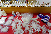 COPY BY TOM BEDFORD<br /> Pictured: Bridal accessories, jewellery and shoes on display at the John Pye Auctions warehouse in Pyle, south Wales, UK.<br /> Re: A bride cried tears of joy after her missing wedding dress was found among a pile of 20,000 gowns in a warehouse.<br /> Meg Stamp, 27, paid &pound;1,300 for the beautiful ivory lace dress but it  was seized by liquidators after a bridal company went bust.<br /> It was boxed up along with 20,000 others and due to be sold for a knock-down price at auction.<br /> But determined Meg banged on the auctioneer door saying: &ldquo;I want my dress back&rdquo;.<br /> Staff at John Pye auctioneers in Port Talbot spent three hours sifting through boxes until they finally found Meg&rsquo;s dream dress.COPY BY TOM BEDFORD<br /> Pictured: at the John Pye Auctions warehouse in Pyle, south Wales, UK.<br /> Re: A bride cried tears of joy after her missing wedding dress was found among a pile of 20,000 gowns in a warehouse.<br /> Meg Stamp, 27, paid &pound;1,300 for the beautiful ivory lace dress but it  was seized by liquidators after a bridal company went bust.<br /> It was boxed up along with 20,000 others and due to be sold for a knock-down price at auction.<br /> But determined Meg banged on the auctioneer door saying: &ldquo;I want my dress back&rdquo;.<br /> Staff at John Pye auctioneers in Port Talbot spent three hours sifting through boxes until they finally found Meg&rsquo;s dream dress.