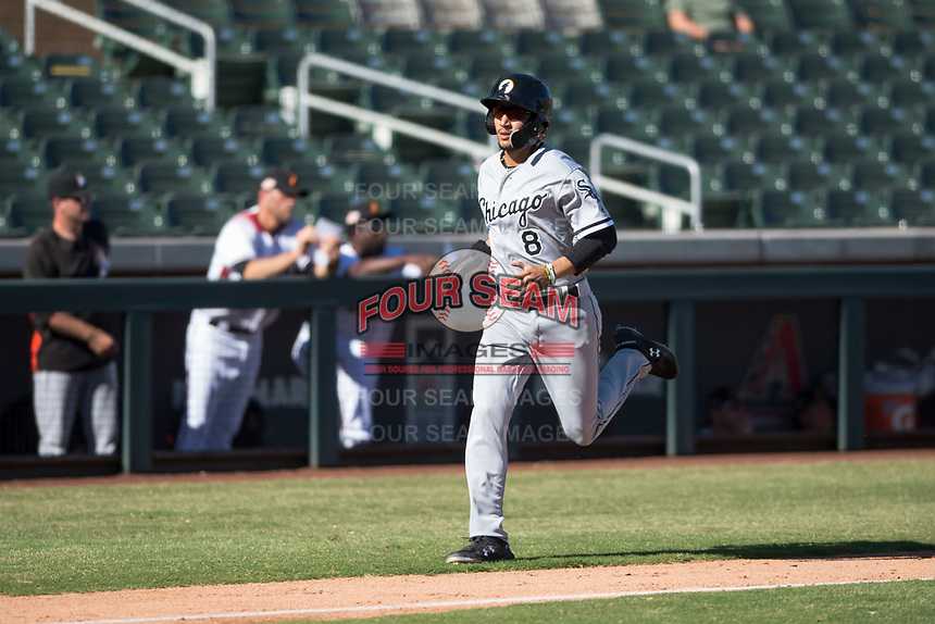 Glendale Desert Dogs second baseman Laz Rivera (8), of the Chicago White Sox organization, runs home during an Arizona Fall League game against the Salt River Rafters at Salt River Fields at Talking Stick on October 31, 2018 in Scottsdale, Arizona. Glendale defeated Salt River 12-6 in extra innings. (Zachary Lucy/Four Seam Images)