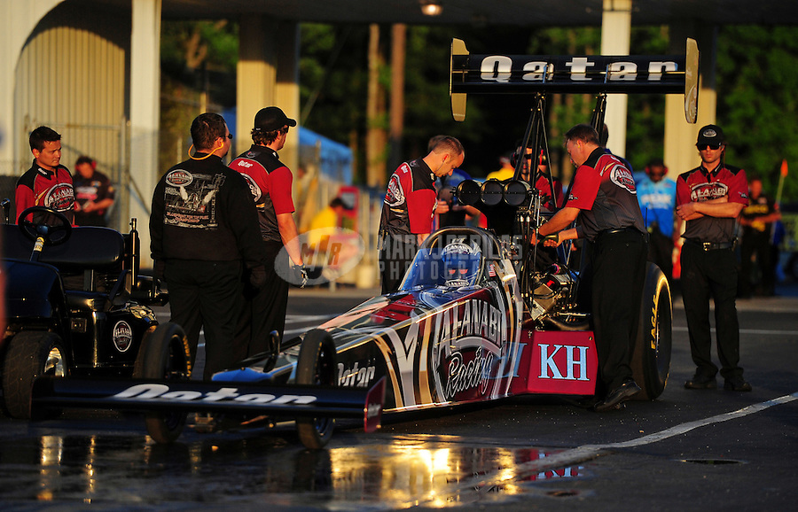 May 4, 2012; Commerce, GA, USA: Crew members surround the car of NHRA top fuel dragster driver Shawn Langdon during qualifying for the Southern Nationals at Atlanta Dragway. Mandatory Credit: Mark J. Rebilas-
