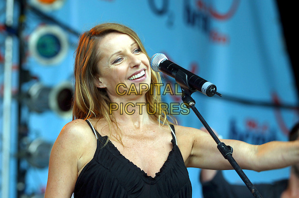 BANANARAMA - KEREN WOODWARD .Performs live in concert at 96.4 BRMB's Party In The Park, Cannon Hill Park, Birmingham, .July 3rd 2005..half length stage gig .Ref: JEZ.www.capitalpictures.com.sales@capitalpictures.com.©Jez Self/Capital Pictures