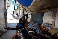"""Ali Mohammud, a Somalia Ethiopia disabled war veteran, lies in a bed  of the former Martini Hospital, his home for more than 30 years, In  Somalia's war torn capital Mogadishu on Tuesday April 22nd 2008.///..Sporadic street fighting between Ethiopian .troops and Islamic fighters trying to bring down Somalia's shaky .government has killed 81 people on April 19 and 20, the head of a .local human rights group said Sunday. .""""The casualties ... were caused by Ethiopians using heavy artillery and .tank shells in residential areas of the war-torn capital. We condemn .this latest fighting,"""" said Sudan Ali Ahmed, chairman of Elman Human .Rights. Besides the 81 dead, 119 people had been wounded, he said. .Reports on Monday April 21 say Ethiopian troops have taken control of a mosque with a large .number of civilians inside following heavy fighting with insurgents. .The reports say a number of civilians were killed inside the mosque and others are being held by Ethiopians against .their will. .This apparent increase in the brutality of attacks may be caused partly by a .recent American decision to classify the Shabab (youth), the Islamic Courts .Union's former military wing, as a terrorist group. Battered by Ethiopian attacks .and by infighting between sub-clans engaged in the insurgency, Shabab .fighters now probably number fewer than 400. But America's decision to .demonise them has boosted jihadist commanders such as Aden Hashi Ayro, .strengthening his reputation for piety and anti-Americanism, which has itself .been boosted by recent missile attacks that have accidentally killed civilians...Philippe Lazzarini, head of the UN Office for the Coordination of Humanitarian Affai .rs (OCHA) Somalia, said on Monday April 21st that the combination of a severe drought, civil insecurity and h .yperinflation was pushing the country to the brink. If the situation were happening a .nywhere else """"it would have triggered outrage"""". .Lazzarini said Somalia was """"on the eve of a massive, mas"""