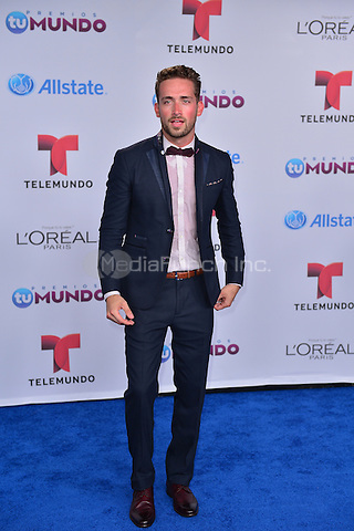 MIAMI, FL - AUGUST 21: Mauricio Henao arrives at Telemundo's Premios Tu Mundo Awards 2014 at American Airlines Arena on August 21, 2014 in Miami, Florida. Credit: MPI10 / MediaPunch