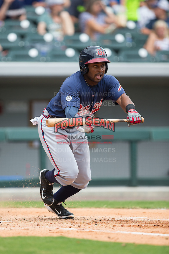 Mycal Jones (5) of the Gwinnett Braves lays down a bunt against the Charlotte Knights at BB&T BallPark on July 3, 2015 in Charlotte, North Carolina.  The Braves defeated the Knights 11-4 in game one of a day-night double header.  (Brian Westerholt/Four Seam Images)