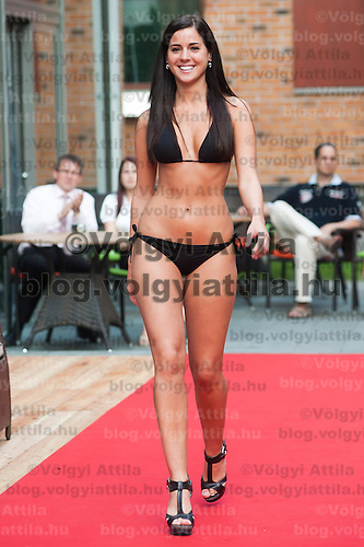 Mercedesz Lukacs a participant of the Beauty Queen contest attends a bikini tour in Hotel Abacus, Herceghalom, Hungary on July 07, 2011. ATTILA VOLGYI