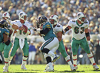 The Dolphins offensive line works to protect Dan Marino during the final game of the legendary quarterback's career, a 62 to 7 Playoff loss by his Miami Dolphins tot he Jacksonville Jaguars in Alltell Stadium, Jacksonville, FL, January 15, 2000. (Photo by Brian Cleary/www.bcpix.com)