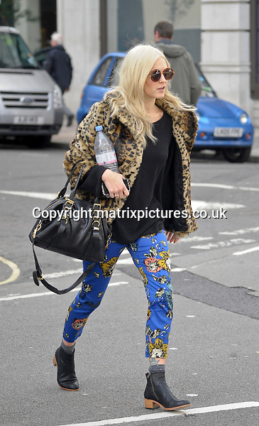 NON EXCLUSIVE PICTURE: MATRIXPICTURES.CO.UK<br /> PLEASE CREDIT ALL USES<br /> <br /> WORLD RIGHTS<br /> <br /> English DJ and TV host Fearne Cotton is pictured leaving London's BBC Radio 1studio.<br /> <br /> She wears a leopard print faux fur coat, paired with azure coloured cigarette trousers.<br /> <br /> OCTOBER 17th 2013<br /> <br /> REF: PSE 136817