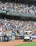 Hideki Matsui,<br /> JULY 28, 2013 - MLB :<br /> Hideki Matsui waves to fans from a cart as he enters the stadium for his official retirement ceremony before the Major League Baseball game between the Tampa Bay Rays and the New York Yankees at Yankee Stadium in The Bronx, New York, United States. (Photo by AFLO)