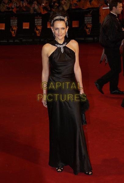 SAFFRON ALDRIDGE.Arrivals at The Orange British Academy Film Awards, .(BAFTA's) Odeon Leicester Square, London, England,.19 February 2006.bafta baftas full length black dress silver hairband hair band .Ref: FIN.www.capitalpictures.com.sales@capitalpictures.com.©Steve Finn/Capital Pictures.