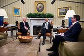 United States President Barack Obama, center, speaks during a meeting with U.S. Secretary of Defense Ashton Carter , right, and U.S. Vice President Joe Biden, left, in the Oval Office of the White House in Washington, D.C., U.S., on Tuesday, Feb. 17, 2015. Carter, sworn in as defense secretary today, inherits an array of defense and foreign policy challenges that are likely to help define the remaining two years of Obama's presidency. <br /> Credit: Andrew Harrer / Pool via CNP