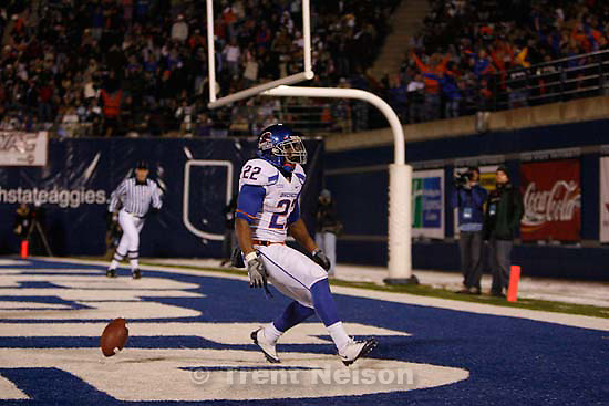 Boise State's Doug Martin celebrates his score, giving Boise State a 14-7 point lead over Utah State at the end of the first half. Utah State vs. Boise State college football Friday, November 20 2009.
