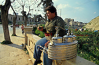 Street vendor selling tea on the sidewalk in Aleppo, Syria.