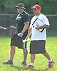 East Islip assistant coaches Mike Gentile, left, and John Caraccia pace the sidelines during football team practice at the high school on Wednesday, August 19, 2015.