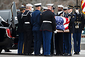 A joint service honor guard loads the casket of former US President George H.W. Bush into the waiting hearse on the East Front of the US Capitol in Washington, DC, USA, 05 December 2018. George H.W. Bush, the 41st President of the United States (1989-1993), died at the age of 94 on 30 November 2018 at his home in Texas.<br /> Credit: Shawn Thew / Pool via CNP