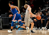 WASHINGTON, DC - DECEMBER 28: Mac McClung #2 of Georgetown hit in the eye by Sa'eed Nelson #0 of American. during a game between American University and Georgetown University at Capital One Arena on December 28, 2019 in Washington, DC.