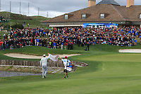 Nacho Elvira (ESP) and his caddy hold up a Spanish flag on the 18th fairway during Round 4 of the Open de Espana 2018 at Centro Nacional de Golf on Sunday 15th April 2018.<br /> Picture:  Thos Caffrey / www.golffile.ie<br /> <br /> All photo usage must carry mandatory copyright credit (&copy; Golffile | Thos Caffrey)