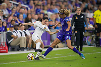 Orlando, FL - Saturday March 24, 2018: Utah Royals midfielder Diana Matheson (10) is challenged by Orlando Pride midfielder Dani Weatherholt (17) during a regular season National Women's Soccer League (NWSL) match between the Orlando Pride and the Utah Royals FC at Orlando City Stadium. The game ended in a 1-1 draw.