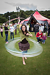 © Joel Goodman - 07973 332324 . 14 September 2013 . Ramsbottom Cricket Club , Ramsbottom , UK . DEBBIE RUBINS of the Ladybird Project with hula hoops . The Ramsbottom Festival . Photo credit : Joel Goodman