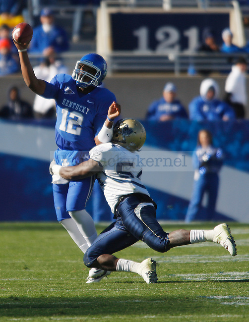 Morgan Newton makes a pass as quarterback in the second half of UK's win over Charleston Southern on  Saturday, Nov. 6, 2010. Photo by Britney McIntosh | Staff