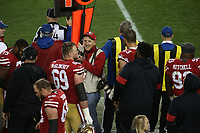 SANTA CLARA, CA - JANUARY 19:  San Francisco 49ers team photographer Michael Zagaris works the sidelines during the NFC Championship Game against the Green Bay Packers at Levi's Stadium on Sunday, January 19, 2020 in Santa Clara, California. (Photo by Brad Mangin)