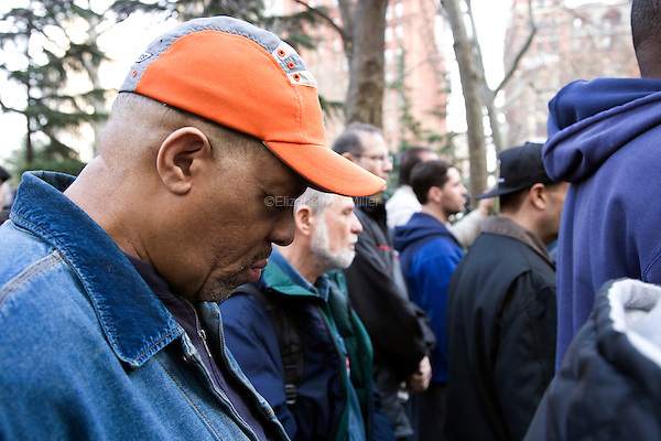 "On the anniversary of Dr. Martin Luther King Jr.'s death, union workers observe a moment of silence at ""Unite and Win: Stand Up for Workers' Rights"" Rally in New York's City Hall Park on 04 April 2011.  The event was held to remind the city's elected officials that workers' rights are human rights, and that those rights will not be destroyed."
