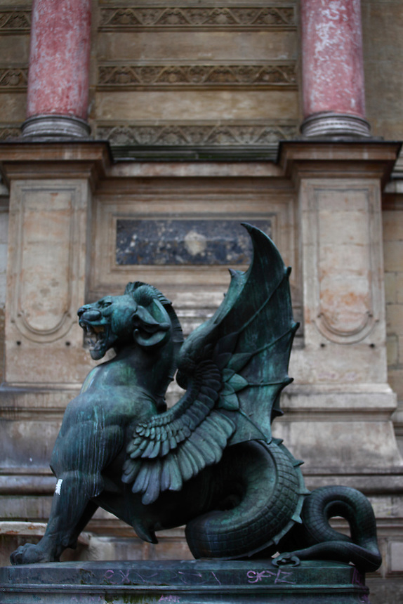 One of the two dragons of the fountain of Saint Michel in Paris, with its lion head, its open wings, and its rolled tail. Digitally Improved Photo.