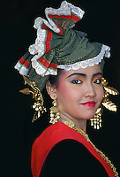 Woman wearing traditional Indonesian dress, Jakarta, Indonesia.