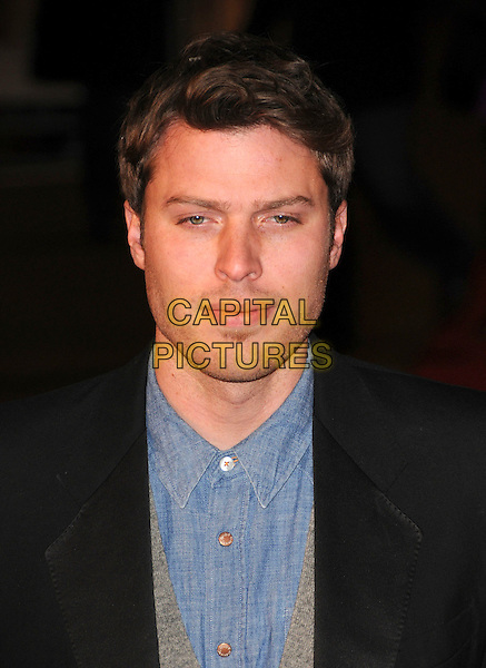 "RICK EDWARDS .At the UK Film Premiere of ""Revolutionary Road"" at the Odeon Leicester Square, London, England, January 18th 2009..portrait headshot blue shirt black jacket .CAP/CAS.©Bob Cass/Capital Pictures"