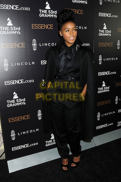 JANELLE MONAE.Essence Salutes Grammy Nominated Artist Janelle Monae at the 2nd Annual Essence Black Women in Music Event held at Playhouse Hollywood, Hollywood, California, USA..February 9th, 2011.full length black hair coif  bow harem trousers hands in pockets cape  pussybow jacket blouse shirt top.CAP/ADM/BP.©Byron Purvis/AdMedia/Capital Pictures.