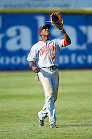 Hagerstown Suns left fielder Isaac Ballou (23) catches a fly ball during the game against the Hickory Crawdads at L.P. Frans Stadium on May 7, 2014 in Hickory, North Carolina.  The Suns defeated the Crawdads 4-2.  (Brian Westerholt/Four Seam Images)
