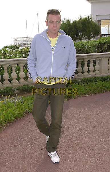 EWAN McGREGOR.Cannes Film Festival, France,.May 2001..full length blue zip up top casual yellow t shirt.Ref: PL.www.capitalpictures.com.sales@capitalpictures.com.©Capital Pictures.