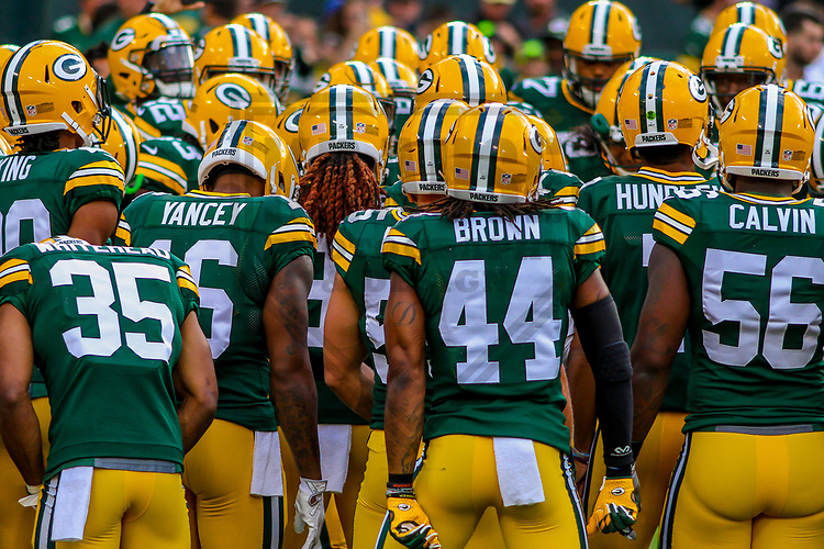 Green Bay Packers players huddle during a preseason football game against the Philadelphia Eagles on August 10, 2017 at Lambeau Field in Green Bay, Wisconsin. Green Bay defeated Philadelphia 24-9.  (Brad Krause/Krause Sports Photography)
