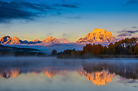 Mt. Moran in the Teton Range greets the early morning sun at Oxbow Bend, Grand Teton National Park, WY.