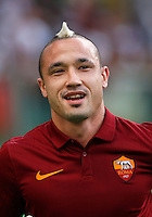 Calcio, amichevole Roma vs Fenerbahce. Roma, stadio Olimpico, 19 agosto 2014.<br /> AS Roma midfielder Radja Nainggolan, of Belgium, greets fans during the team's presentation, prior to the friendly match between AS Roma and Fenerbache at Rome's Olympic stadium, 19 August 2014.<br /> UPDATE IMAGES PRESS/Riccardo De Luca